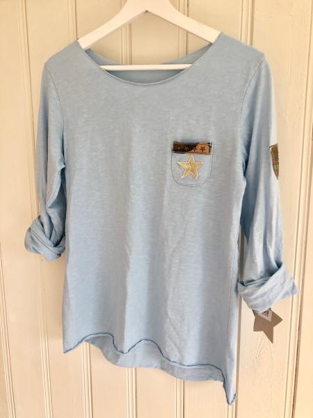 58a71a8e Bomullsgenser med liten lomme blå · Bomullsgenser med liten lomme blå
